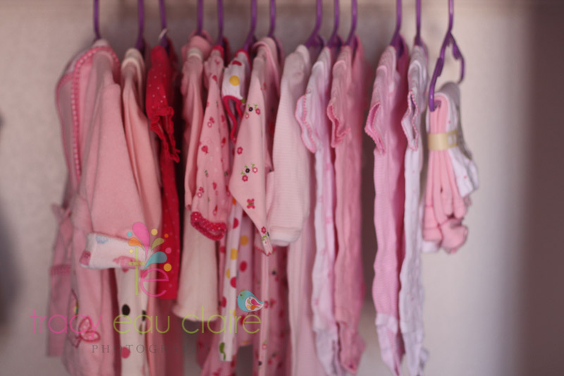 stock images pink newborn clothes hanging in closet tracy eau