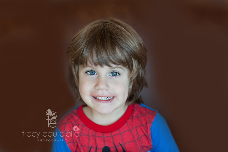 little boy in spider man pajamas